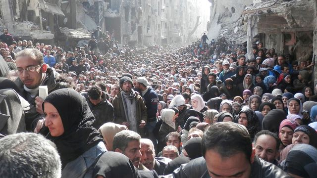 residents-wait-to-receive-food-aid-distributed-by-the-u-n-relief-and-works-agency-unrwa-at-the-besieged-al-yarmouk-camp-south-of-damascus_4799984